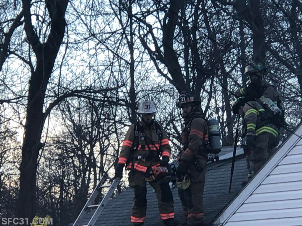 Battalion Chief McCarthy and Firefighter Desiderio on the rooftop.