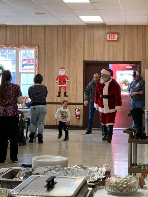 Santa appears at our breakfast fundraiser.