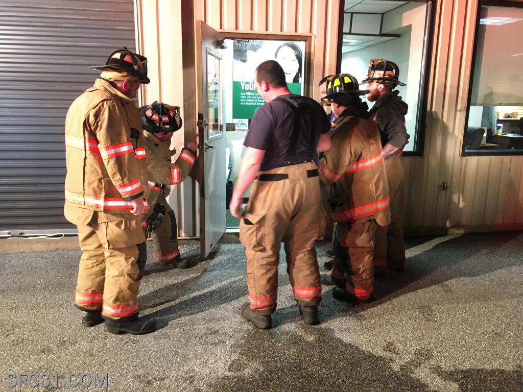Firefighters conduct a post-incident review.