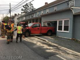 A vehicle crashed into a structure in Sadsburyville.