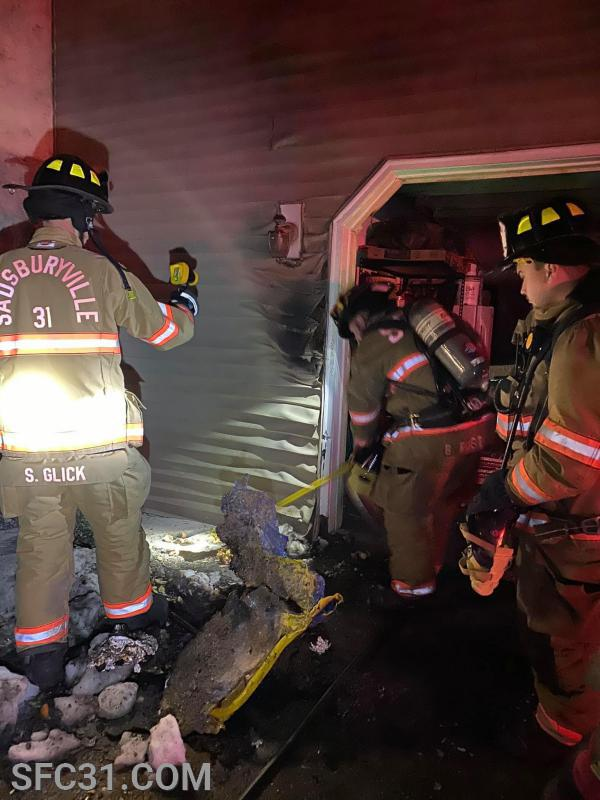Firefighters use a thermal imaging camera on the structure to check for heat or fire in the walls.