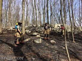 Sadsburyville Firefighters working the ridge for hot spots.