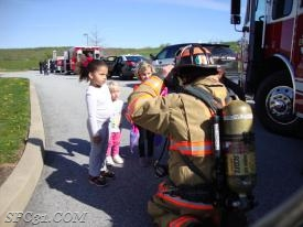 Firefighter Rust educates a young child on what to do if they ever had an encounter with a firefighter at their house.