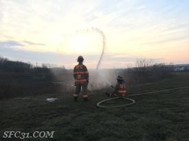 Sadsburyville firefighters manage a hose line during Monday's training.