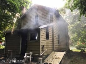 Upon arrival of firefighters, smoke was visible from the exterior of a 2 story dwelling.