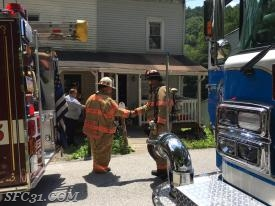 Past Chief Patton and Past Chief Supplee shaking hands on scene of the house fire.