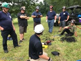 Firefighters trained with ropes used to make rescues in low angle situations.
