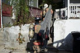 Sadsburyville Firefighters deploy ladders to windows for means of egress.