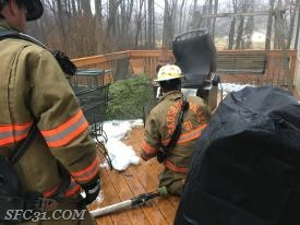 A grill was on fire and began melting the siding of a structure.