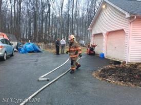 Crews break down the hose line.