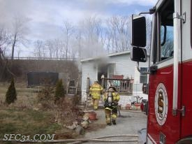 Sadsburyville firefighters make entry into the smoke filled dwelling.