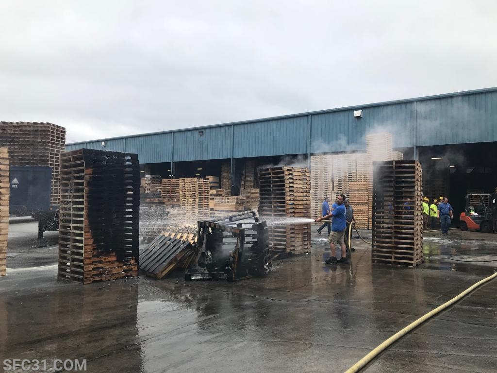 Multiple pallets were involved in the fire.