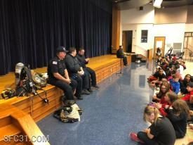 Firefighters provided a fire prevention assembly at the Rainbow Elementary School.