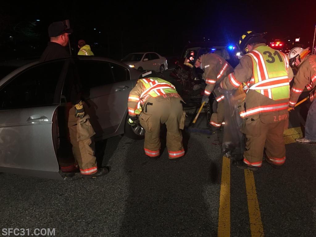 Sadsburyville firefighters clean up an accident scene on Lincoln Highway.