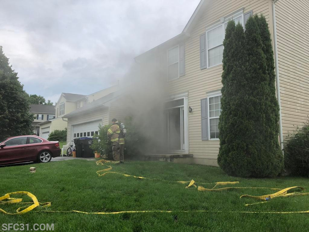 Firefighters arrived to find smoke showing from a 2 story dwelling.